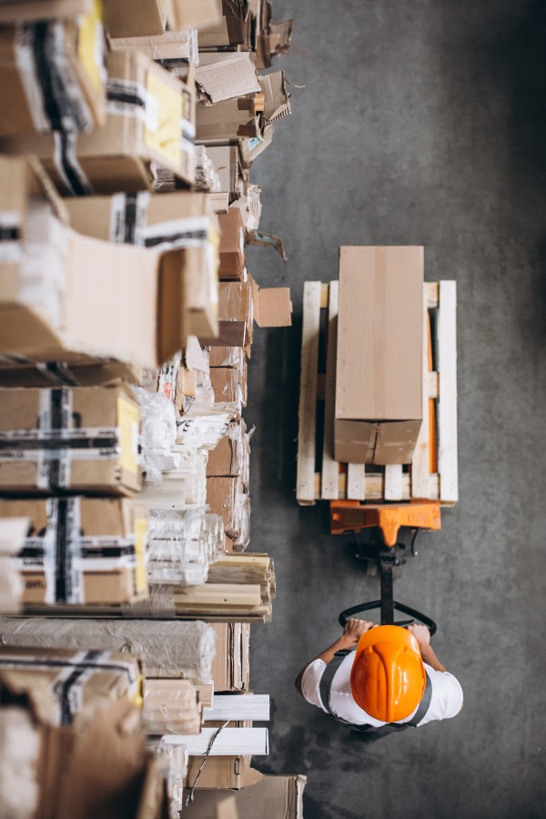 young-man-working-at-warehouse-with-boxes--1-